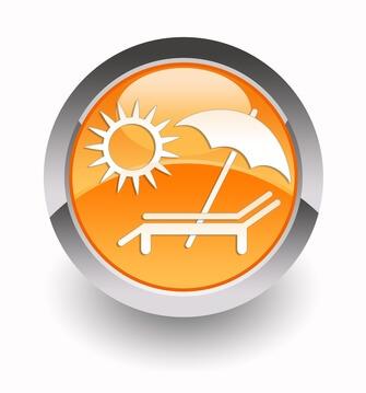 Ein Schild warnt vor übermäßiger Sonneneinstrahlung außerhalb des Solariums.